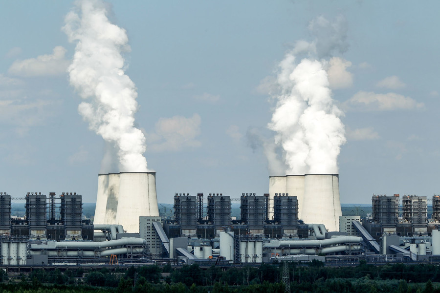 JAENSCHWALDE, GERMANY - AUGUST 10: Exhaust plumes from cooling towers at the Jaenschwalde lignite coal-fired power station, which is owned by Vattenfall, August 10, 2010 at Jaenschwalde, Germany. The Jaenschwalde power plant, built by the former East German government in the 1980s, emits 25 million tons of CO2 annually and is among the biggest single producers of CO2 emissions in Europe. (Photo by Sean Gallup/Getty Images)